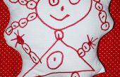 Wendung ein Kindes in einer bestickten Plushie Zeichnung
