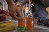 Bohren Sie Glasflaschen zu einem Wasserstand