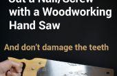 Schneiden der Nägel oder Schrauben mit einer Handsäge Holzbearbeitung