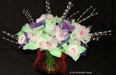 Ein Blumenstrauß der Blumen gemacht aus Knoblauch Mesh-Taschen